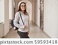 Beautiful brunette girl student in eyeglasses. 59593418