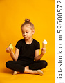 Thoughtful little dancer or gymnast choosing between punching bag and ice cream 59600572