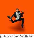 Man in casual office style clothes jumping isolated on studio background 59607941
