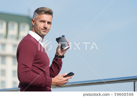 Coffee on the go. Handsome man hold takeaway 59608506