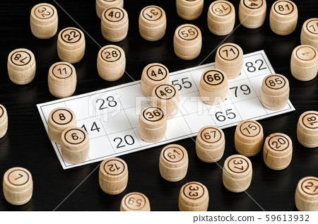 Wooden lotto barrels and card for playing on a 59613932