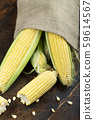 sweet young corn on wooden background 59614567