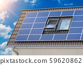 Solar panels for green energy on the tiled roof of 59620862