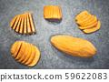Fresh sweet potatoes on baking paper. 59622083