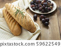 French baguettes on wooden table, rustic style. 59622549