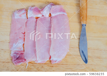 Uncooked slies of fresh pock meat on wood 59638235