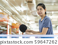 woman is playing ping pong 59647262