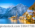 Classic postcard view of famous Hallstatt lakeside town in the Alps with traditional passenger ship on a beautiful cold sunny day with blue sky and clouds in winter, Salzkammergut region, Austria 59647786