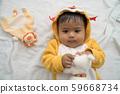 Cute asian baby lying and play teddy dog 59668734