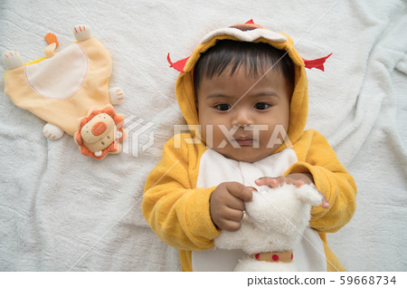 Cute asian baby lying and play teddy dog 59668734