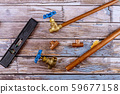 Set of brass plumbing fitting tools on wooden 59677158