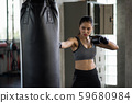 Strong woman practice Thai boxing in gym 59680984