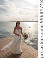 Full figure of a young bride at Lake Garda, Torri del Benaco Italy,  59684748