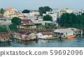Floating houses on Mekong River 59692096