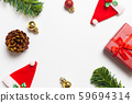 Top view Christmas composition. Gifts, Pine cones and Christmas Santa Claus Hats red decorations on white background. Happy new year concept. 59694314