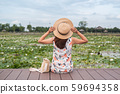 Young woman traveler sitting and looking lotus 59694358