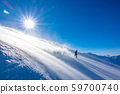 Snowboarder Raises a lot of Snow Dust in the Sun 59700740