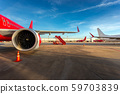 airplane engine in airport, with plane waiting for passenger, luggage, re fuel for take off again after landing at international airport for air transportation to clear blue sky 59703839
