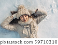 Funny Woman Lying on the Snow 59710310
