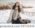 Winter Woman Having Fun Outdoors 59710345