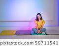 Smiling asian girl sitting cross legs on the floor 59711541