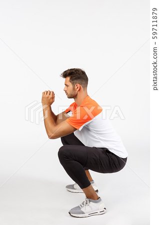 Vertical, full-length profile shot young masculine male athlete in sportswear, do squats, sit and 59711879