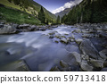 The flowing river Ruetz with stones and trees 59713418