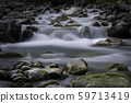 Big stones in mountain flowing stream 59713419