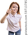 Cheerful young woman looking through magnifying glass 59713785