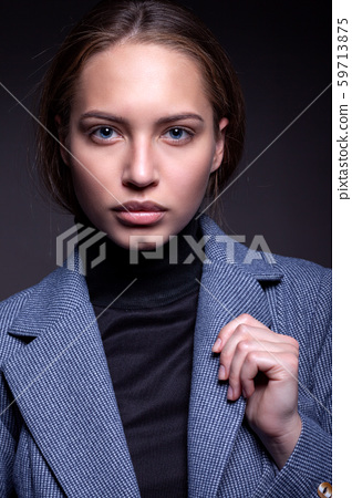Portrait of a beautiful girl in a simple style in 59713875