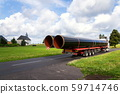 Truck transporting large steel oil and gas pipes, excessive load and heavy delivery concept 59714746