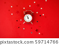 Festive Christmas background with alarm clock on red background in minimal style. 59714766