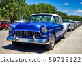 Classic american car on the streets of Havana in Cuba 59715122