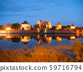 Malbork castle by night with reflection in Nogat river 59716794