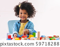 Little afro girl smiling and playing colorful 59718288