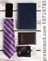 Tie, purse and passport. 59719785