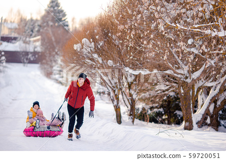 Family of dad and kids vacation on Christmas eve outdoors 59720051