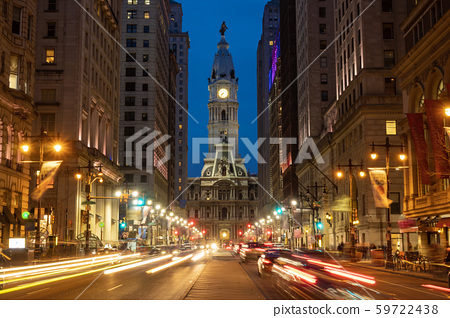 Scene of Philadelphia\'s landmark historic City Hall building at twilight time with car traffic light, United States of America or USA, history and culture for travel concept