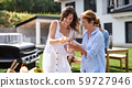 Portrait of multigeneration family outdoors on garden barbecue, grilling. 59727946