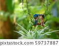 Gesturing dolls or toys showing love in the garden 59737887