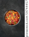 Chili con carne, a Mexican stew with beans, ground meat, corn, and chilli peppers, overhead shot on 59744457
