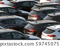 Lot of cars being transported to trade location 59745075