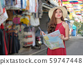 woman traveler tourist with map traveling on 59747448