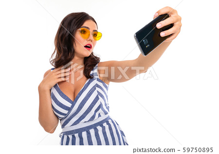 Beautiful young woman with perfect smile, sunglasses do selfie, isolated on white background 59750895