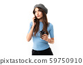 Caucasian female with cap drinks coffee and call to the phone, picture isolated on white background 59750910