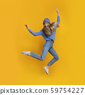 Breezy girl in blue jumping in the air 59754227