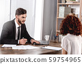 Job Interview. Employer talking taking notes concentrated on candidate sitting in office 59754965
