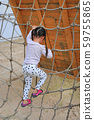 little kid girl at playground playing on climbing 59755865