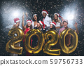 Group of cheerful young people golden balloons 2020 59756733