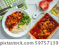 Chicken fillet baked in tomato sauce with corn and beans, served with boiled rice. Mexican style cuisine. 59757139